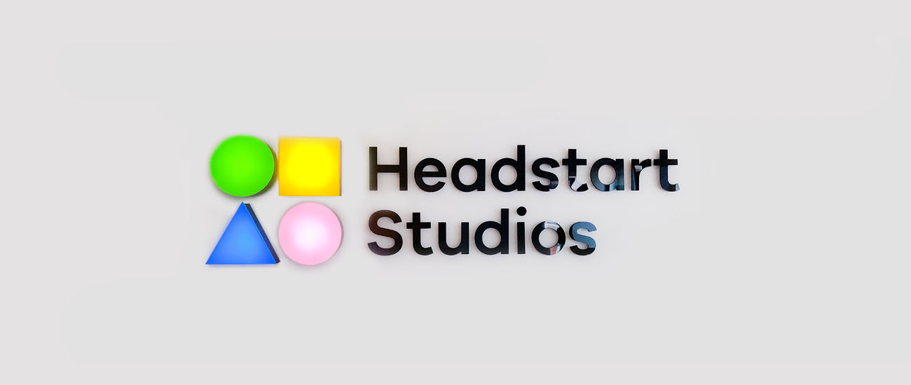 Headstarts Studio Logo in 2D and 3D letters mounted on the wall