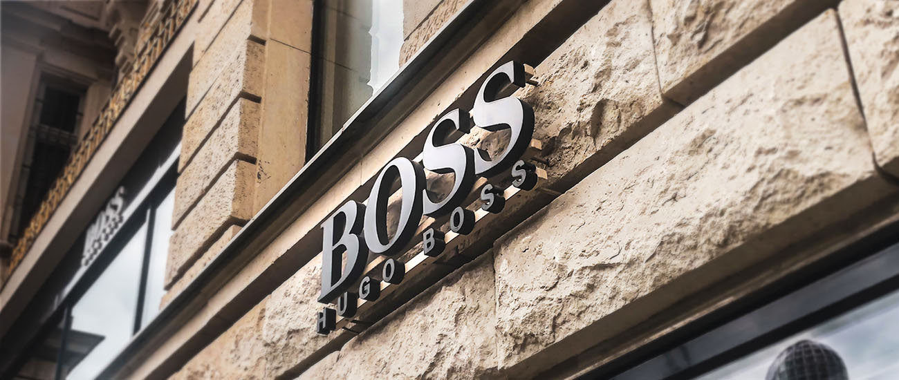 Boss logo in 2D letters outdoor advertising mounted on the wall