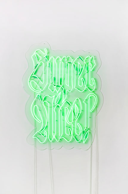"Neon green neon sign on a wall with the words ""Super Nice"""