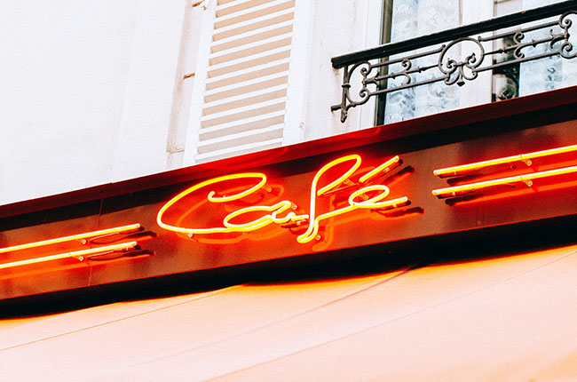 "Neon light with the words ""Cafe"""
