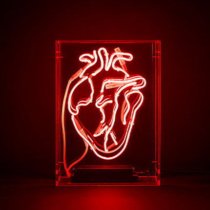 Organic heart made of red neon lights in an acrylic box