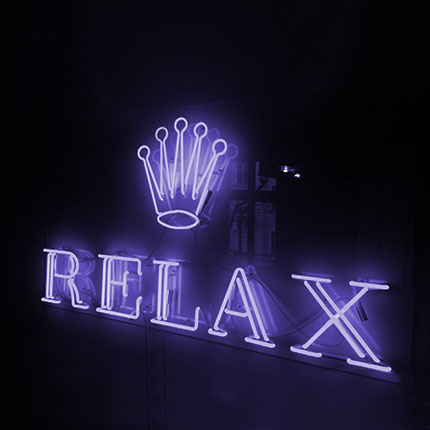 "Neon with with the word ""Relax"""