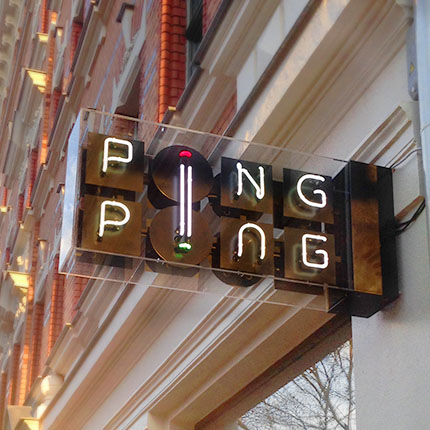 Ping Ping logo in neon letters in a nose debt as outdoor signage