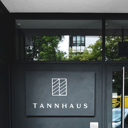 Tannhaus lightbox suspended and mounted on the wall of the house