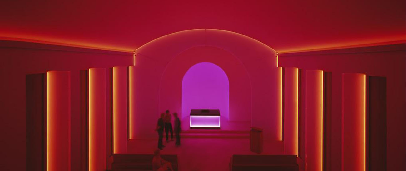 Red light in a room as an exhibition by neon artist James Turrell
