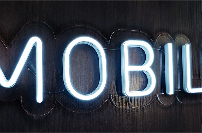 "Logo lettering with the letters ""MO"" made of LED neon pre-mounted on a plexiglass plate"