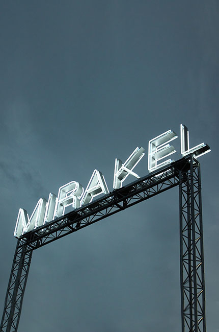 Miracle logo on a roof at night from neon light