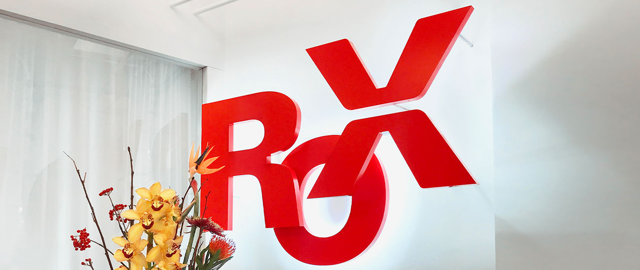 The lettering Rox in red 2D letters with white backlight mounted on a wall