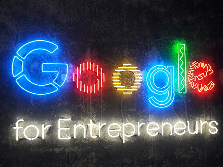 Google logo as a neon motif in bright colors