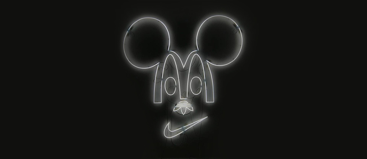 "Mickey Mouse neon light art object. The eyes are formed from the ""M"" of McDonalds, the nose from the Adidas logo and the mouth from the Nike logo"