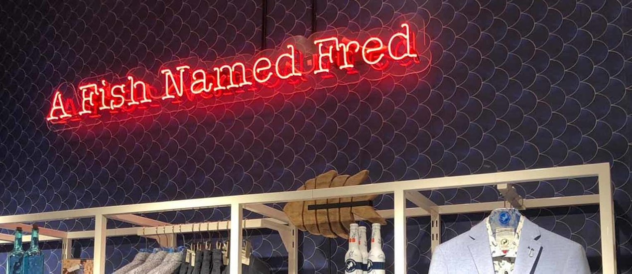 A Fish Named Fred logo as red neon light lettering
