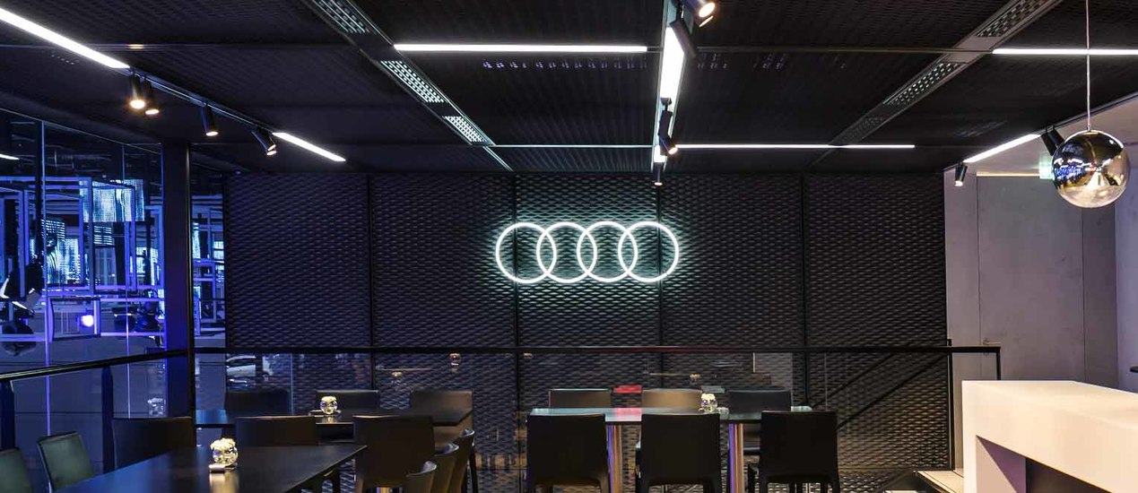 Audi logo installed as an illuminated neon motif on a wall