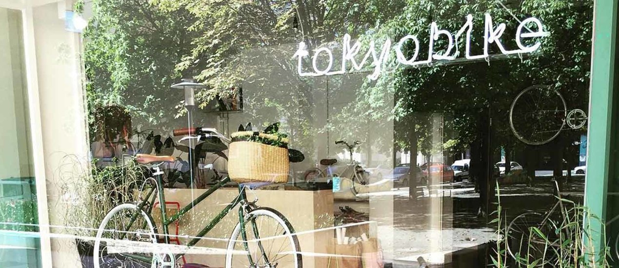 Toyko Bikes logo installed in neon letters hanging in a shop window