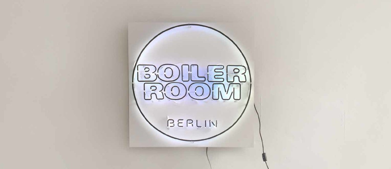 Boiler Room logo installed in a bright neon light on a wall