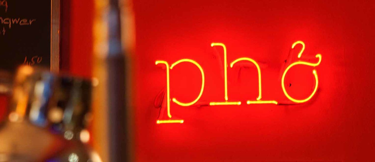 "Neon light motif in red with the words ""Pho"""