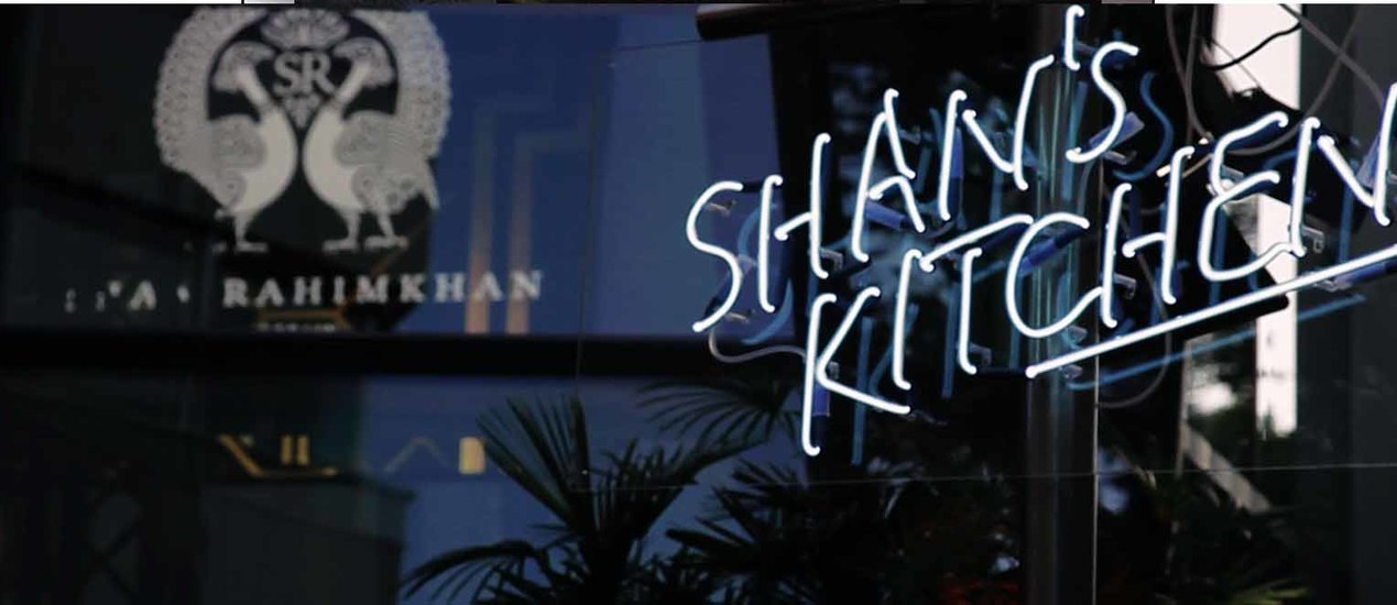 "Shan Rahimkhan neon lettering with the words ""Shan's Kitchen"""