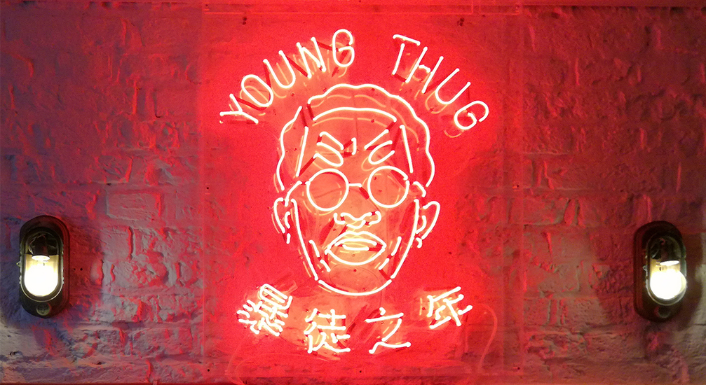 Young Thug logo in neon letters