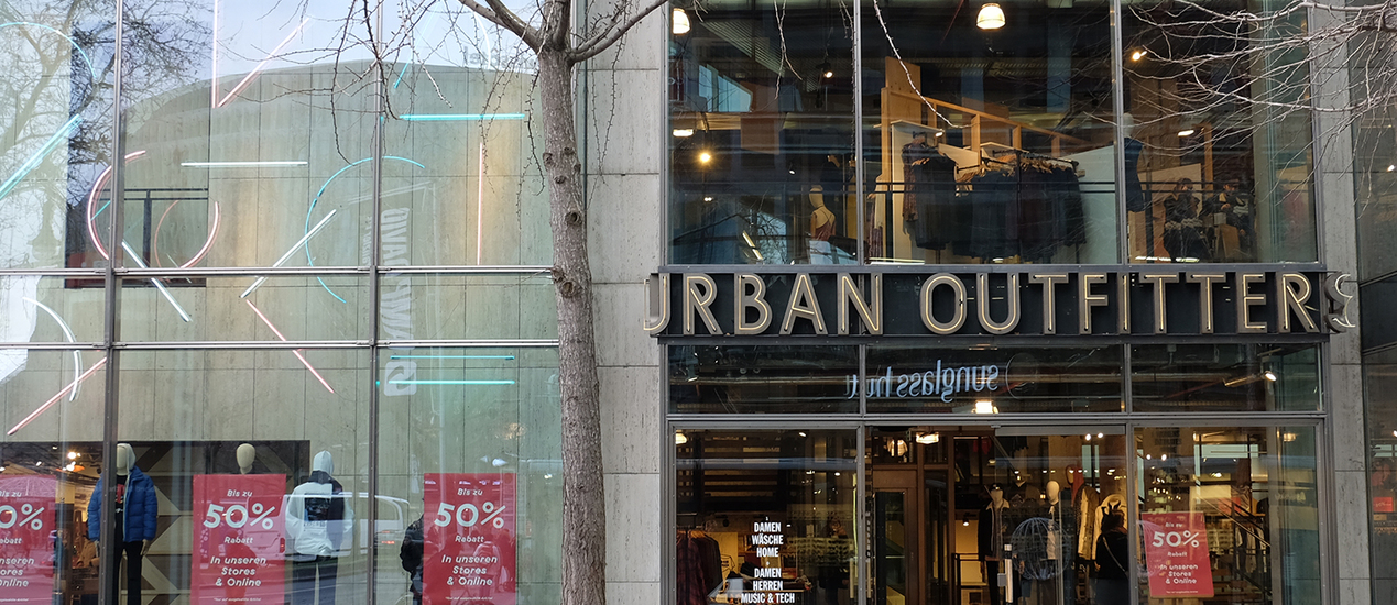 Urban Outfitters storefront with colorful hanging neon tubes