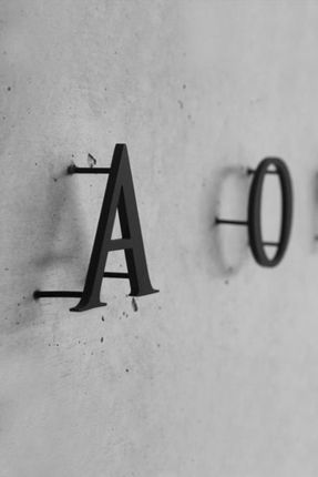 """Direct to wall 2D Letters """"A O"""" on the concrete wall"""